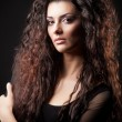 Foto Stock: Portrait of glamour young girl with beautiful long curly hair