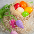 Colorful easter eggs in the basket — Foto de Stock
