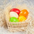 Colorful easter eggs in the basket — Stock Photo #20166627