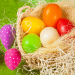 Colorful easter eggs in the basket — Stock Photo #20166629