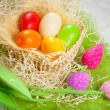 Colorful easter eggs in the basket — Stock Photo #20166631