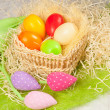 Colorful easter eggs in the basket — Stock fotografie