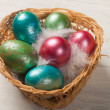 Colorful easter eggs in the basket — Stockfoto