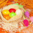 Colorful easter eggs in the basket — Stock Photo #20166663