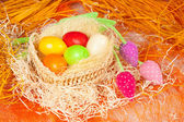 Colorful easter eggs in the basket — Stock Photo
