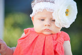 Little baby girl in a summer park — Stock Photo