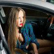 Beautiful lady sitting in a car — Foto de Stock
