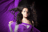 Portrait of young girl dancing with long textile — Stock Photo