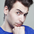 Funny face of young man, close up shot — Stock Photo