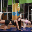 Two young sporty woman in the gym centre — Stock Photo #27379907