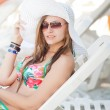 Beautiful young woman on the beach — Stock Photo #28838509