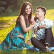 Beautiful couple in park — Stockfoto