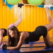 Two young sporty woman in the gym centre — Stock Photo #28838535