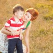 Stock Photo: Happy little boy in the park with mother