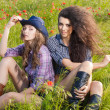Two beautiful womans enjoying in the nature — Stock Photo #30661397