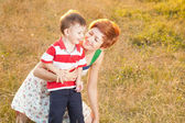 Happy little boy in the park with mother — Stock Photo