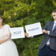 Stock Photo: Happy Groom and Bride in park with signs