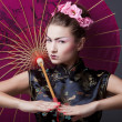 Fashion geisha in studio — Stockfoto
