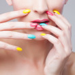 Colored manicure, Woman face with rainbow makeup and manicure — Stock Photo