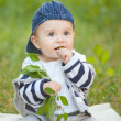 Baby boy sitting on the grass — стоковое фото #33463555