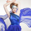 Sexy woman in fluttering blue dress — Stock Photo