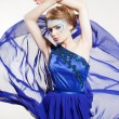 Stock Photo: Sexy woman in fluttering blue dress