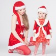 happy mother with little daughter iin the santa claus clothes — Stock Photo