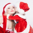 Happy mother with little daughter iin the Santa Claus clothes — Стоковая фотография