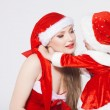 Happy mother with little daughter iin the Santa Claus clothes — Photo