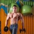 Muscular guy in fitness club — Stock Photo