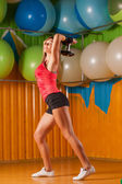 Sporty woman doing exercises in the gym centre — Stock Photo