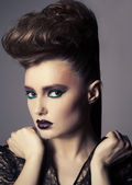 Fashion beauty portrait of sexy woman with creative hairstyle and make-up — Stok fotoğraf