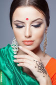 Fashion portrait of beautiful woman in indian sari — Stockfoto