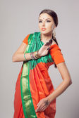 Fashion portrait of beautiful woman in indian sari — Stock Photo