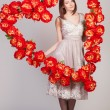 Beautiful woman with heart of flowers — Stock Photo #38739281