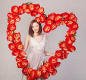 Beautiful woman with heart of flowers — Foto de Stock