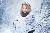 Beauty woman in winter forest — Stock Photo