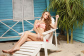 Sexy young woman in bikini standing in beach bungalow — Foto Stock