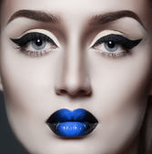 Fashion gothic woman with sexy blue lips — Stock Photo
