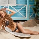 Sexy young woman in bikini standing in beach bungalow — Stock Photo