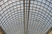 Modern glass roof inside shop center — Stock Photo