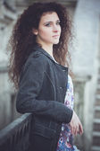 Portrait of a young woman on the streets of old city — Stock fotografie