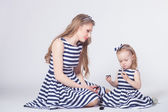 Young mother playing with daughter — Stock Photo