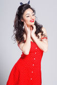 Sexy pin up girl in red dress, isolated on white — Stock Photo