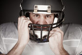 American football player  on the uniform, studio shoot — Stock Photo