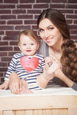 Young mother playing with little baby — Stock Photo