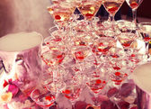 Champagne in glasses with fresh cherry on table - party background — Stock Photo