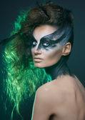 Fashion crow girl with white eyes — Stock Photo