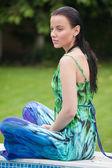 Fashion woman doing yoga exercises on outdoors — Foto de Stock