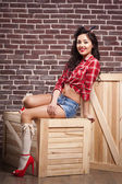 Sexy pin up girl in in short shorts, isolated on white — Stock Photo